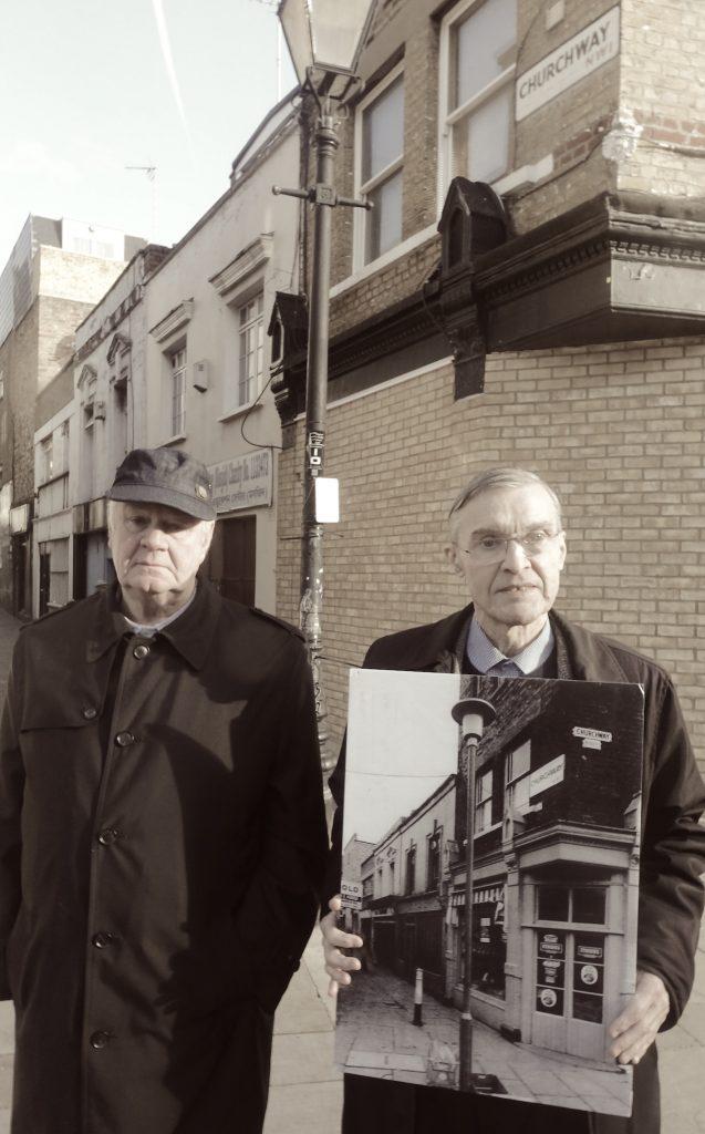 Two men in street.