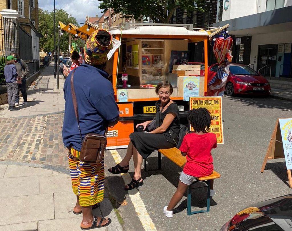 People stood around a decorated van