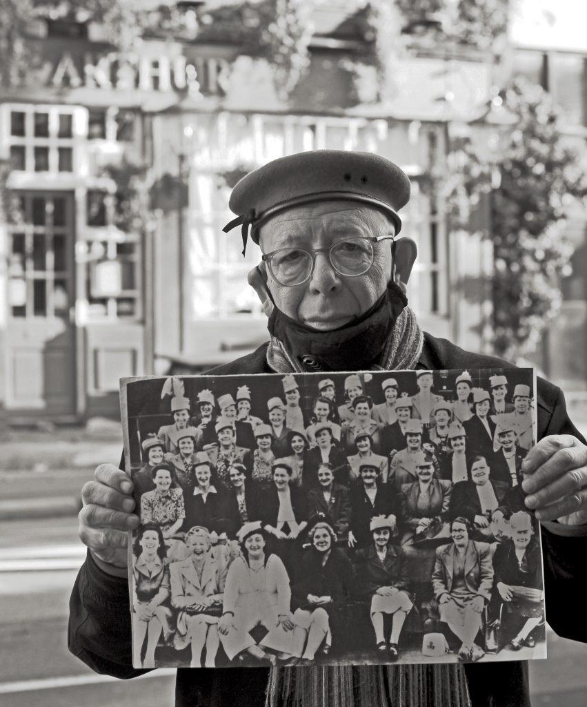 Older man outside pub