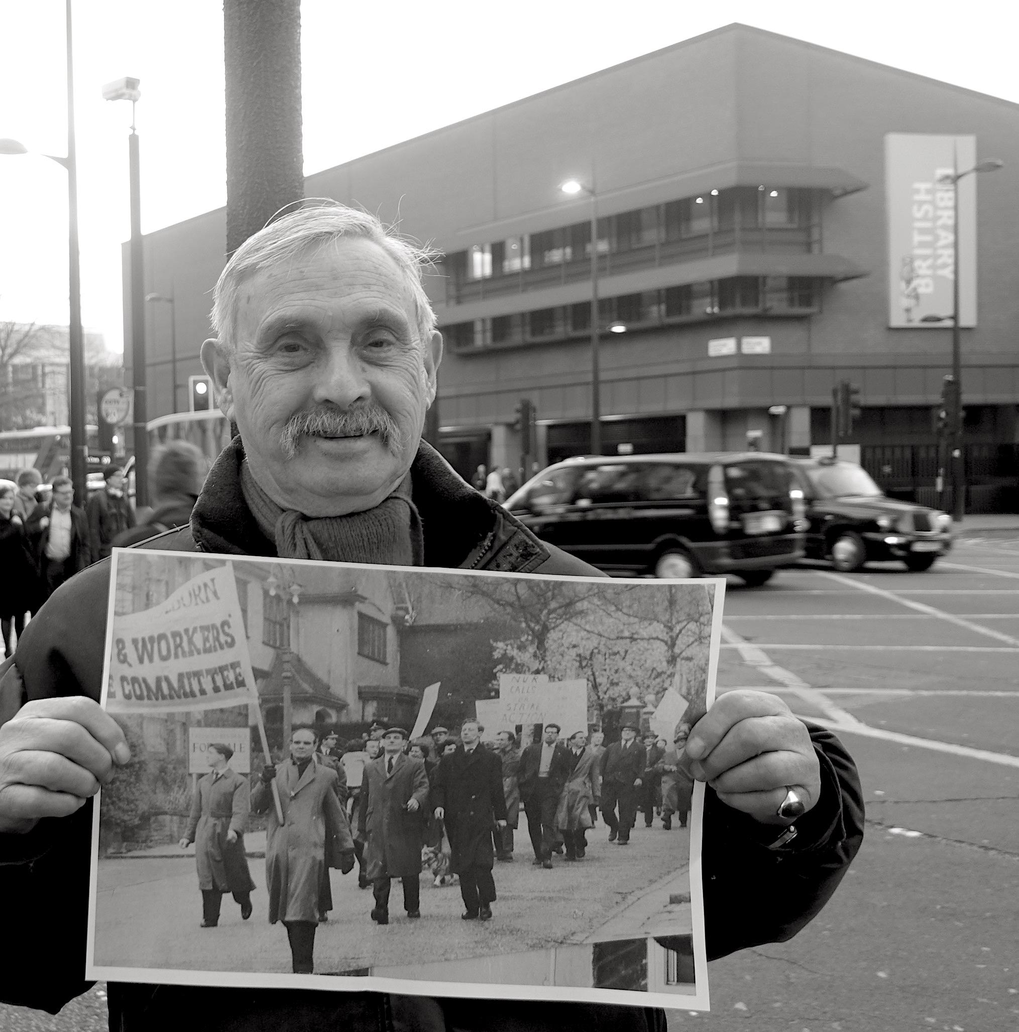 Man holding photo