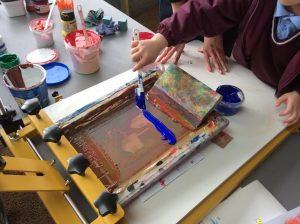 Screenprinting in action.
