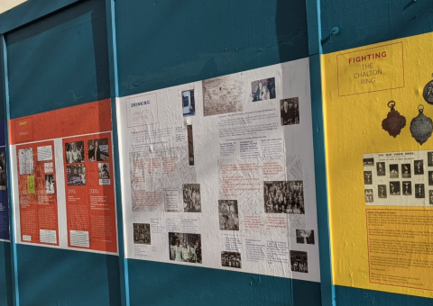 Posters on a wall.