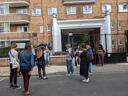 People outside a block of flats